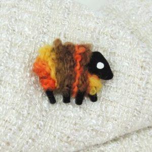 sheep|pin|brown_orange_yellow|front