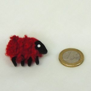 ruby red sheep pin scale euro-coin