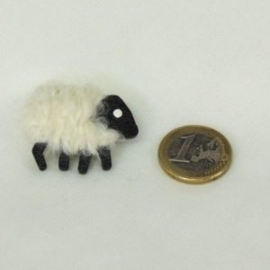 white sheep pin scale euro-coin